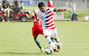 TeamUSA defender Allan Rodriguez Lopez avoids a tackle from Portugal midfielder Diogo Prioste (8)  during a CONCACAF boys under-15 championship soccer game, Saturday, August 10, 2019, in Bradenton, Fla. Portugal defeated Team USA 3-0 and advanced to the finals against Slovenia. (Kim Hukari/Image of Sport)