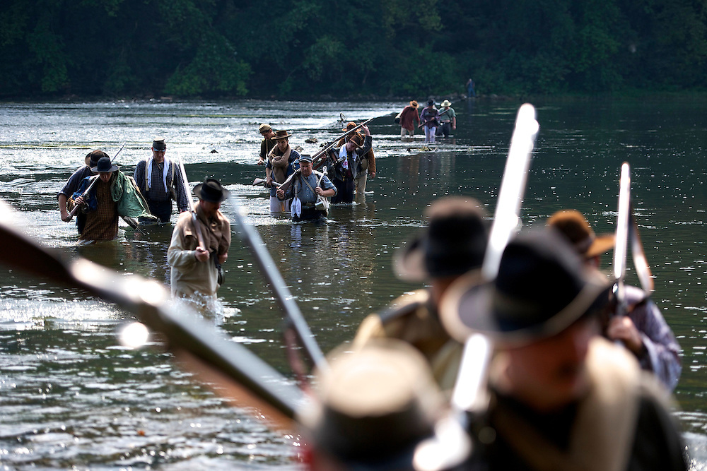 14th Tennessee infantry Confederate soldiers ford the Potomac River during General A.P. Hill's 18 mile march from Harper's Ferry, WV to Sharpsburg, MD during the 150th Antietam Civil War Reenactment on September 7, 2012.