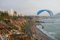 A paraglider takes in a view of the Pacific Ocean along the shoreline in the Miraflores neighborhood of Lima, Peru.