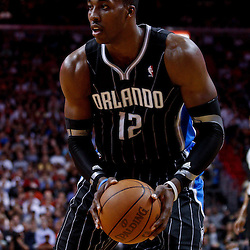 March 3, 2011; Miami, FL, USA; Orlando Magic center Dwight Howard (12) during the first half against the Miami Heat at the American Airlines Arena. The Magic defeated the Heat 99-96.    Mandatory Credit: Derick E. Hingle
