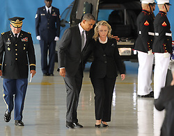 US President Barack Obama and Hillary Clinton attend the Transfer of Remains Ceremony in Washington, DC, USA on September 14, 2012, marking the return to the United States of the remains of the four Americans killed this week in Benghazi, Libya, at Joint Base Andrews. Photo by Molly Riley/ABACAUSA.COM