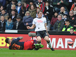 Derby Stephen Warnock goes in with a double footer challenge on Readings Danny Williams tahts gets him his second Yellow Card and sent Off, Derby County v Reading, FA Cup 5th Round, The Ipro Stadium, Saturday 14th Febuary 2015