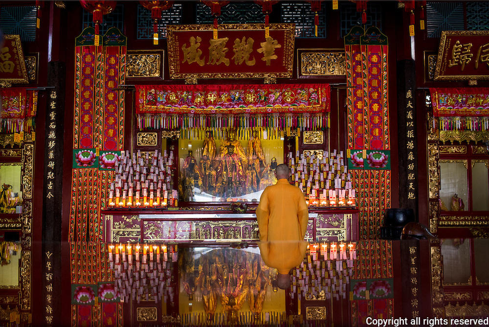 A priest at the Guan Yin / Goddess of Mercy Temple, George Town, Penang, Malaysia