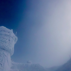 Photographer on ths summit of New Hampshire's Mount Washington in winter.