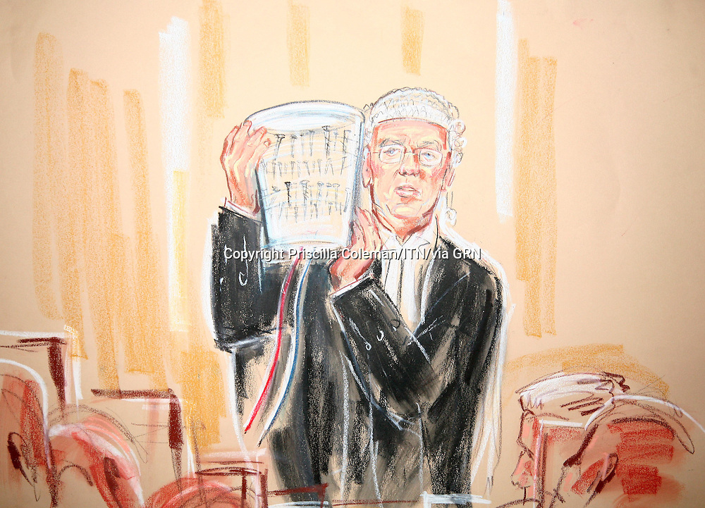 ©Priscilla Coleman ITV News.Supplied by: Photonews Service Ltd Old Bailey.Pic shows:NIGEL SWEENY QC AT WOOLWICH CROWN COURT TODAY, WHERE HE IS HOLDING A CONTAINER AS USED BY THE 21 JULY DEFENDANTS TO FACILITATE A BOMB..Illustration: Priscilla Coleman ITV News
