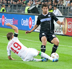 15.09.2011, UPC Arena, Graz, AUT, UEFA Europa League , Sturm Graz vs Lokomotive Moskau, im Bild George Popkhadze (SK Sturm Graz, #2, Defense) und Roman Shishkin (Lok Moskau, #49) // during UEFA Europa League football game between Sturm Graz and Lokomotive Moskau at UPC Arena in Graz, Austria on 15/09/2011. EXPA Pictures © 2011, PhotoCredit: EXPA/ E. Scheriau