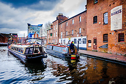 Canal boats on Birmingham Canal Old Line in the centre of the city of Birmingam, England<br /> <br /> (c) Andrew Wilson | Edinburgh Elite media