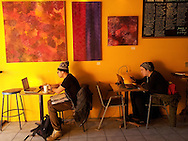 Canada, Ontario. Windsor. Two students (I presume) studying  at computers in MILK Coffee Bar. 2015.