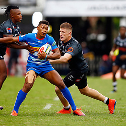 S'busiso Nkosi and Jacques Vermeulen of the Cell C Sharks tackle Damian Willemse of the DHL Stormers during the Super Rugby match between Cell C Sharks and DHL Stormers at Jonsson Kings Park on March 02, 2019 in Durban, South Africa. (Photo by Steve Haag)