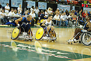 July 7th, 2006: Anchorage, AK - White team member Michael Schecherbauer (2) avoids the Blue team defense as White defeated Blue in the gold medal game of Quad Rugby at the 26th National Veterans Wheelchair Games.