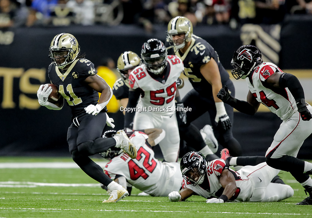 Nov 22, 2018; New Orleans, LA, USA; New Orleans Saints running back Alvin Kamara (41) breaks away from Atlanta Falcons safety Jordan Richards (29) and linebacker Duke Riley (42) during the first quarter at the Mercedes-Benz Superdome. Mandatory Credit: Derick E. Hingle-USA TODAY Sports