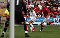Photo: Paul Thomas.<br /> Crewe Alexandra v Liverpool. Pre Season Friendly. 22/07/2006.<br /> <br /> Craig Bellamy  of Liverpool (C) passes the ball.