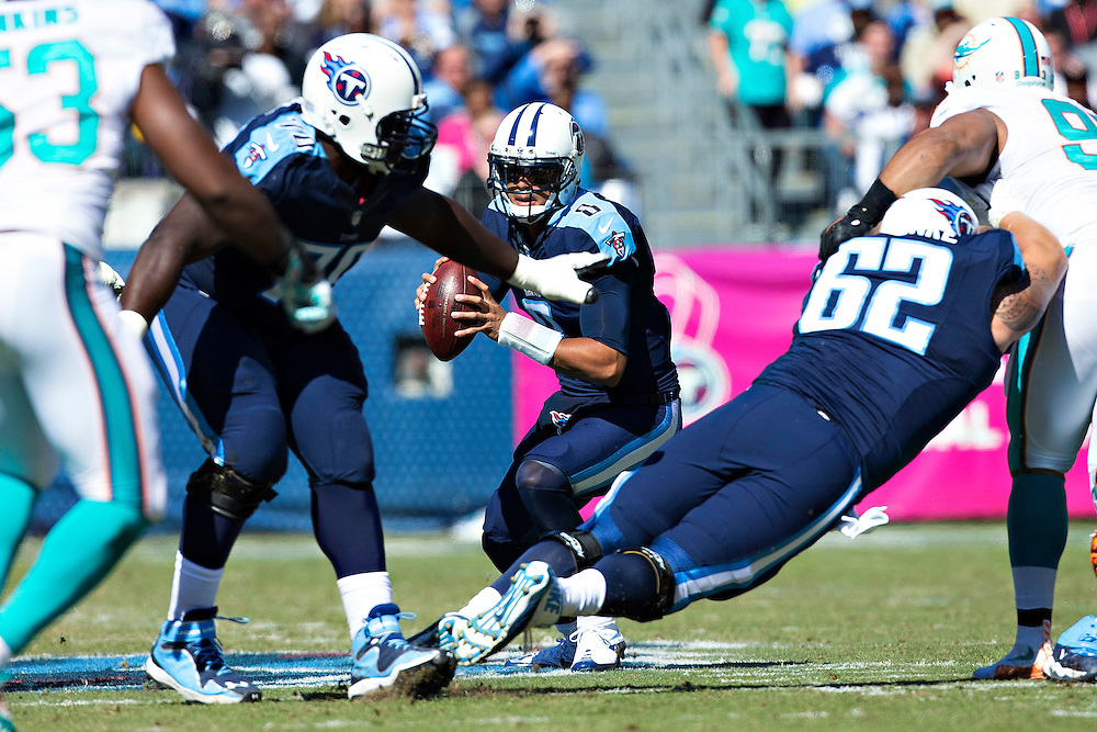 NASHVILLE, TN - OCTOBER 18:  Marcus Mariota #8 of the Tennessee Titans scrambles to avoid the rush during a game against the Miami Dolphins at LP Field on October 18, 2015 in Nashville, Tennessee.  The Dolphins defeated the Titans 38-10.  (Photo by Wesley Hitt/Getty Images) *** Local Caption *** Marcus Mariota