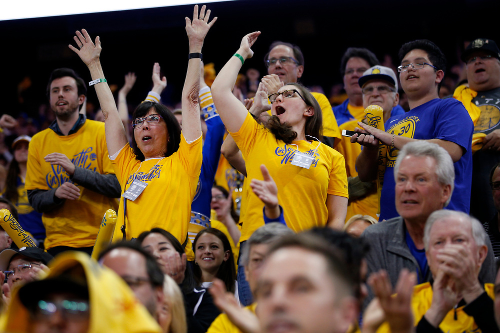 From center left: Cathy Greenwold and Carrie Peterson cheer during the fourth quarter of Game 2 of the NBA Western Conference semifinals between the Golden State Warriors and New Orleans Pelicans at Oracle Arena, Tuesday, May 1, 2018, in Oakland, Calif. The Golden State Warriors won 121-116.