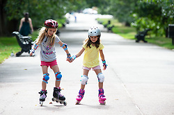 ©Licensed to London News Pictures 30/08/2019.<br /> Greenwich ,UK.  Roller blading girls. People out and about in Greenwich Park, Greenwich, London today enjoying the hot sunny weather. (permission granted) Photo credit: Grant Falvey/LNP