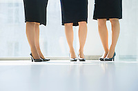 Low section of businesswomen standing in office