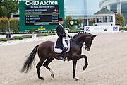 Andreas Helgstrand - Akeem Foldager<br /> World Equestrian Festival, CHIO Aachen 2013<br /> © DigiShots