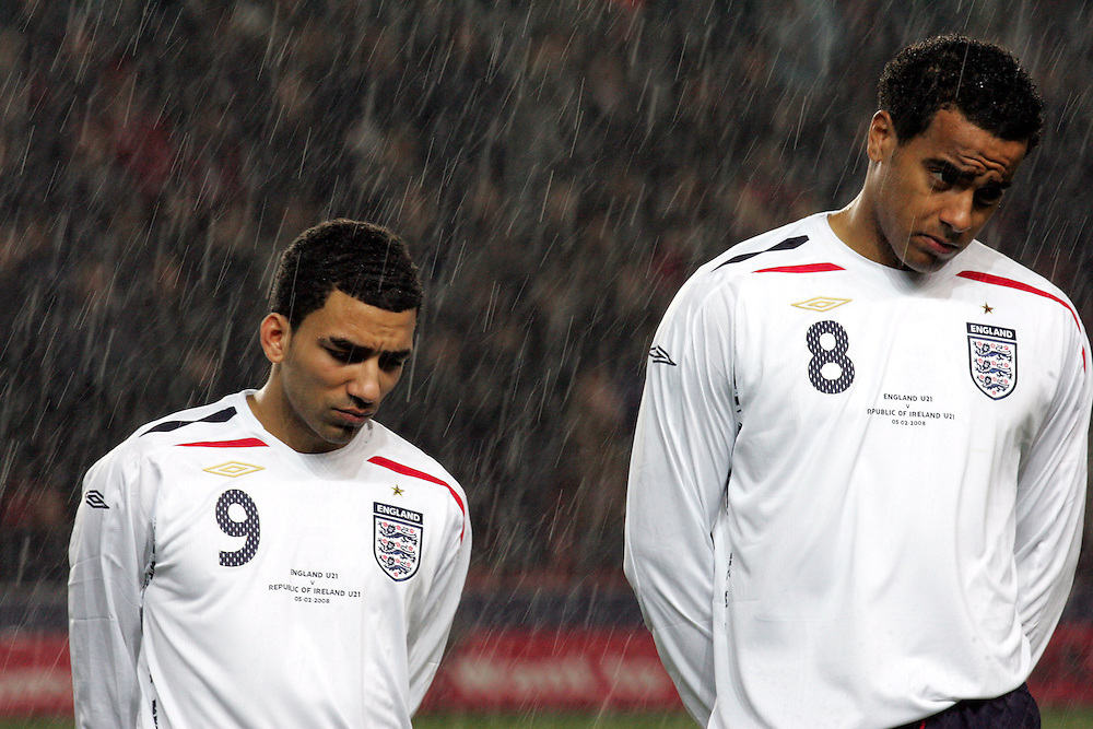 Aaron Lennon (L) and Tom Huddlestone line up in the heavy rain for the national anthem. England v Republic of Ireland, Uefa Under-21 Championship Qualifier, Tuesday 5th February 2008, St Marys, Southampton.