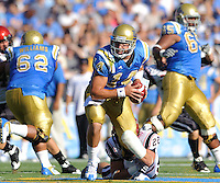 Redshirt freshman quarterback Kevin Prince (14) escapes from junior linebacker Andrew Preston during the UCLA Bruins' 33-14 victory over the the San Diego State University Aztecs 33-14 at the Rose Bowl in Pasadena, Calif., on Saturday, Sept. 5, 2009.