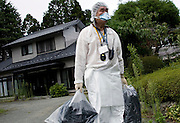 Takashige Kowata leaves his home with for what he believes will be the last time after he and other residents were allowed briefly to return and collect valuables and other belongings from their homes inside the nuclear exclusion zone in Okuma, Fukushima Prefecture, Japan on Aug. 31 2011. For the residents it was the first time to return to their homes since being evacuated, and Kowata had found his place had been broken into. Robert Gilhooly Photo