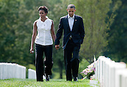 U.S. President Barack Obama and First Lady Michelle Obama walk together during a visit to Arlington National Cemetery in Washington on September 10, 2011.      REUTERS/Joshua Roberts    (UNITED STATES)