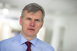 "© Licensed to London News Pictures . Salford Royal Hospital , Greater Manchester , UK . FILE PICTURE DATED 12/05/2013 of DAVID DALTON , Chief Executive of Salford Royal Hospital ,  who has been awarded a Knighthood for his service in the NHS , having worked to turn the once failing Salford Royal in to one of Britain's top performing hospitals . "" To be honoured in this way is not something that I could ever have imagined when I joined the NHS as an administrative trainee almost 35 years ago "" he said . Photo credit : Joel Goodman/LNP"