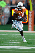 AUSTIN, TX - AUGUST 30:  M.J. McFarland #85 of the Texas Longhorns breaks a tackle against the North Texas Mean Green during the 1st quarter on August 30, 2014 at Darrell K Royal-Texas Memorial Stadium in Austin, Texas.  (Photo by Cooper Neill/Getty Images) *** Local Caption *** M.J. McFarland
