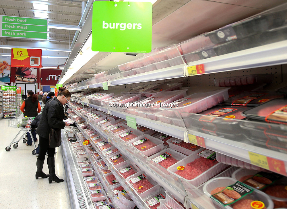 A customer picks up fresh meat at an Asda supermarket in London, capital of Britain, Feb. 15, 2013. Asda has withdrawn its fresh beef bolognese sauce after tests for horse DNA came back positive. It is the first time since the horsemeat scandal unfolded that horse DNA has been found in fresh produce., February 15, 2013. Photo by Imago / i-Images...UK ONLY