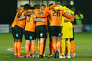 Barnet players huddle before kick-off during The FA Cup fourth round match between Barnet and Brentford at The Hive Stadium, London, England on 28 January 2019.