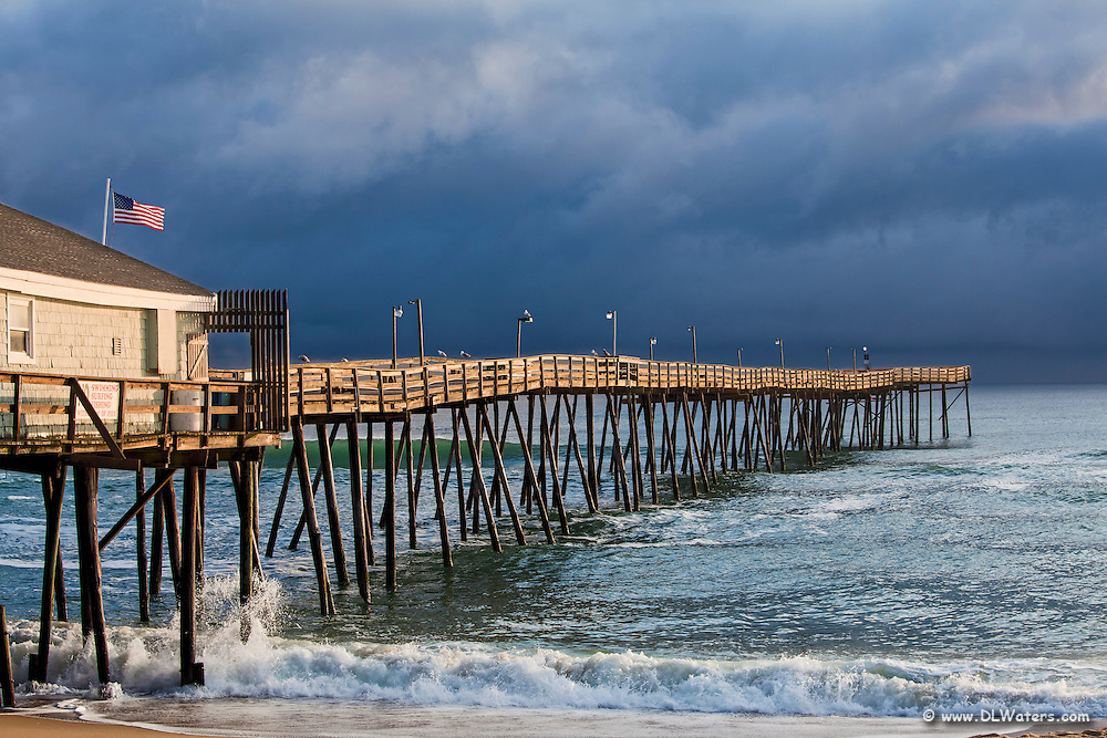 Sunshine on Avalon pier on a stormy afternoon.