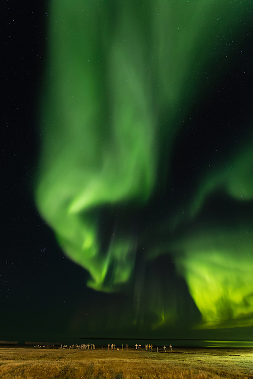 Aurora over Beaufort Sea and cemetery of Kaktovik on the North Slope of Alaska. Autumn. Evening.