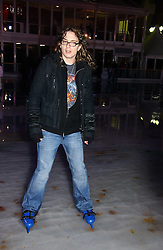 Rock vocalist and guitarist JUSTIN HAWKINS from The Darkness at the opening of the Natural History Museum's ice rink, Cromwell Road, London on 14th November 2006.<br /><br />NON EXCLUSIVE - WORLD RIGHTS