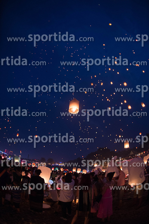 People set sky lanterns into the air along the Lancang River in Jinghong City, southwest China's Yunnan Province, April 13, 2016, to celebrate the new year on the calendar of the Dai ethnic group. EXPA Pictures © 2016, PhotoCredit: EXPA/ Photoshot/ Hu Chao<br /> <br /> *****ATTENTION - for AUT, SLO, CRO, SRB, BIH, MAZ, SUI only*****