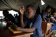 Darla Jean Baptiste, 10, a fourth grader, now attends school in a tent at Haiti's only golf course now home to tens of thousands of earthquake survivors at the Petion-Ville Club golf course on March 5. 2010.....'