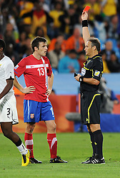 Aleksandar Lukovic (Serbia) is shown the red card and sent off  during the 2010 FIFA World Cup South Africa Group D match between Serbia and Ghana at Loftus Versfeld Stadium on June 13, 2010 in Pretoria, South Africa.