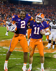November 21, 2009; Clemson, SC, USA; Clemson Tigers quarterback Kyle Parker (11) and safety DeAndre McDaniel (2) celebrate after the game against the Virginia Cavaliers at Memorial Stadium.  Clemson defeated Virginia 34-21.