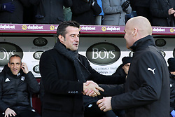 Watford manager Marco Silva (left) and Burnley manager Sean Dyche shake hands before the Premier League match at Turf Moor, Burnley.
