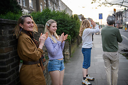 © Licensed to London News Pictures. 16/04/2020. London, UK. Residents bang cooking pots and clap from on the streets of West London at 8pm this evening, joining people across the country expressing their gratitude for the NHS and those working with it who continue to grapple with the coronavirus epidemic. To date COVID-19 has claimed over 1300 in the UK, almost double last week's figure. Photo credit: Guilhem Baker/LNP