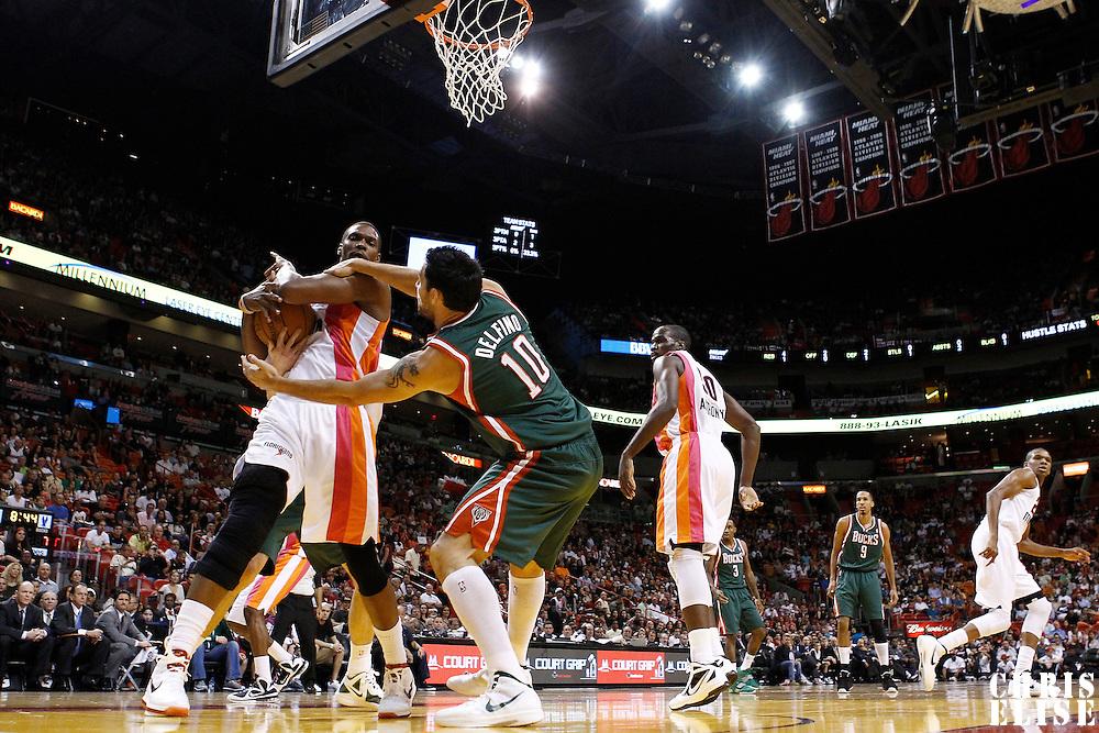 22 January 2012: Miami Heat power forward Chris Bosh (1) vies for the rebound with Milwaukee Bucks small forward Carlos Delfino (10) during the Milwaukee Bucks 91-82 victory over the Miami Heat at the AmericanAirlines Arena, Miami, Florida, USA.