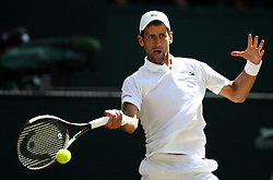 Novak Djokovic in action on day thirteen of the Wimbledon Championships at the All England Lawn Tennis and Croquet Club, Wimbledon.