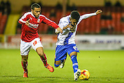 Walsall's Rico Henry fends off Swindon Town's Louis Thompson during the Sky Bet League 1 match between Swindon Town and Walsall at the County Ground, Swindon, England on 24 November 2015. Photo by Shane Healey.