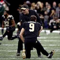 Dec 24, 2016; New Orleans, LA, USA; New Orleans Saints head coach Sean Payton talks to quarterback Drew Brees (9)  before a game against the Tampa Bay Buccaneers at the Mercedes-Benz Superdome. Mandatory Credit: Derick E. Hingle-USA TODAY Sports