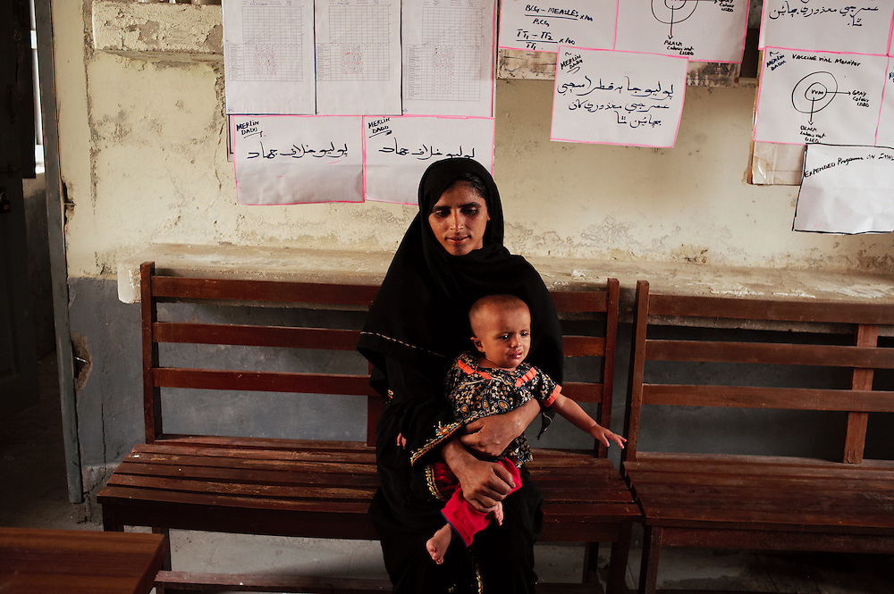 A mother and child wait in the government health clinic, Barrat Khan Lagar, Dadu, Sindh, Pakistan on July 5, 2011.