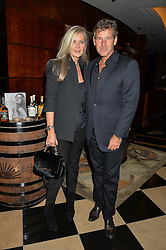 AMANDA WAKELEY and HUGH MORRISON at the London launch of Casamigos Tequila hosted by Rande Gerber, George Clooney & Michael Meldman and to celebrate Cindy Crawford's new book 'Becoming' held at The Beaumont Hotel, Brown Hart Gardens, 8 Balderton Street, London on 1st October 2015.
