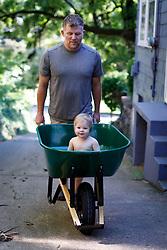 Gemma Marie 10 months in a wheelbarrow and climbing steps, Saturday, July 07, 2018  at Cedar Shake Shack in Louisville .