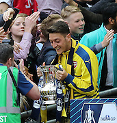 Arsenal's Mesut Özil with the FA Cup during the The FA Cup match between Arsenal and Aston Villa at Wembley Stadium, London, England on 30 May 2015. Photo by Phil Duncan.