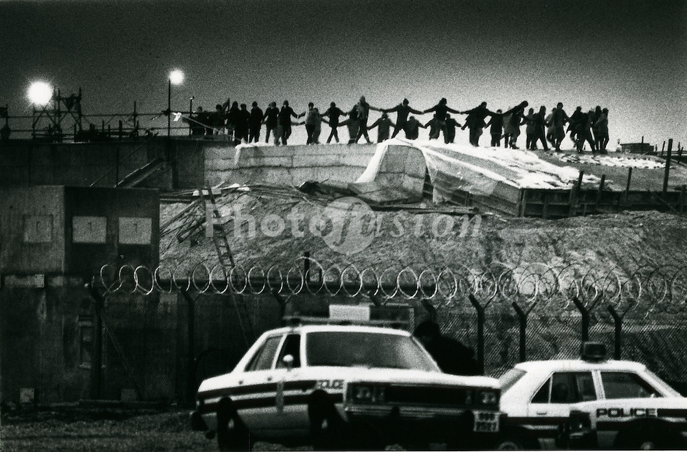 Greenham Common protest; Dancing on the silos at dawn New Year's day; 1 January 1983; USAF air base; Berkshire