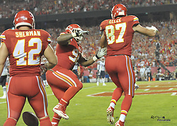 Sep 29, 2014; Kansas City, MO, USA; Kansas City Chiefs tight end Travis Kelce (87) is congratulated by nose tackle Dontari Poe (92) after Kelce scores during the second half against the New England Patriots at Arrowhead Stadium. The Chiefs won 41-14. Mandatory Credit: Denny Medley-USA TODAY Sports