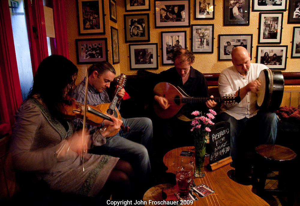 Declan Coree on mandolin along with other traditional musicians at Tig Coili pub in Galway City, Co. Galway, Ireland on Wednesday, Nov. 25, 2009. (Photo/John Froschauer)