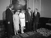 Annie Maguire Visits Tanaiste At Iveagh House. (R61)..1987..07.07.1987..7th July 1987..As part of her campaign to prove the Innocence of the Maguire 7 and The Guildford 4, Annie Maguire took her case to The Tanaiste, Brian Lenihan, at Iveagh House in Dublin. Mrs Maguire's contention was that the 4 and 7 were wrongly convicted using suspect and fraudulent evidence. The 4 and 7 were convicted in England for pub bombings which was said were carried out by the IRA who took their bombing campaign from Northern Ireland to the streets of English cities...Pictured posing for pictures at Iveagh House, Dublin, were; Mr David Andrews TD, member of an all party group interested in the Guildford 4 and Maguire Family, Annie Maguire, Therese Smalley, Errol Smalley, Chairman of the Guildford 4 and Maguire Family Relatives Support Group and An Tanaiste Brian Lenihan TD, Minister for Foreign Affairs.